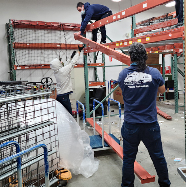 Valley's Silicon Valley Movers disassemble a racking system