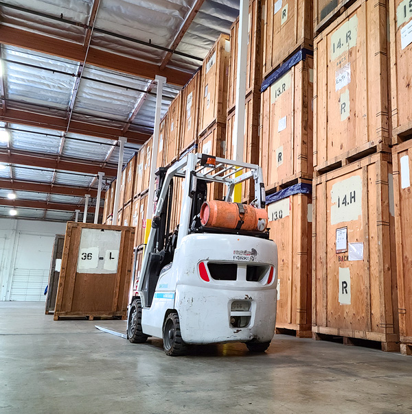 Inside warehouse with forklift at Valley Relocation