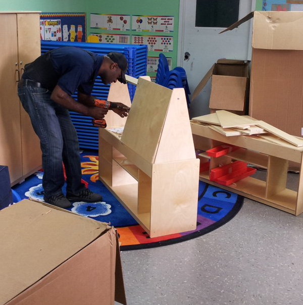 Our crew disassemble cabinet at an elementary school move