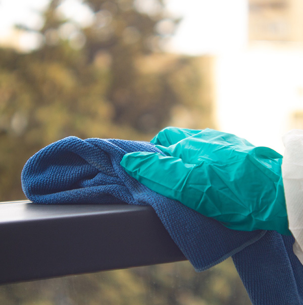 Cleaning and Sanitizing Office windows and sills