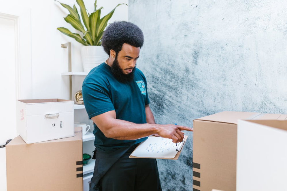 A technology mover is working with some boxes for specialized transportation logistics