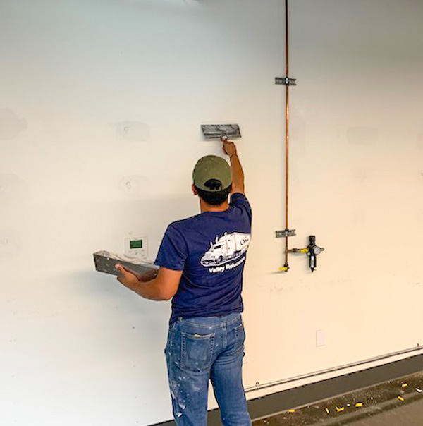 Drywall Patch Paint and Repair crew member on the job