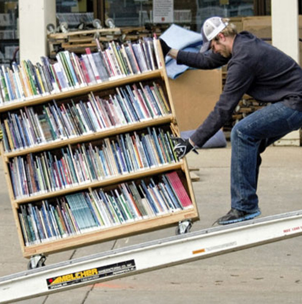 School College and University Library mover crew load library books onto truck
